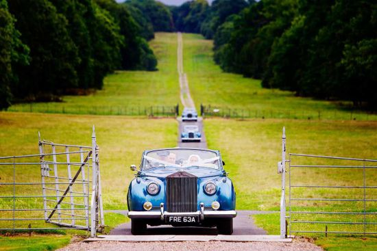The happy newly wed couple arriving at Chillington Hall in style